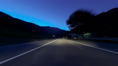 obíhat : Fast driving at Vallnord - La Cortinada (Andorra). Time Lapse Circulating quickly at evening by road (sequence 3 of 4). Logos, license plates and advertising, have been unfocused manually frame by frame. Time Lapse - Vehicle shot - Point of view - Lon