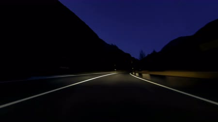 obíhat : Fast driving at Vallnord - LLorts (Andorra) .Time Lapse. Circulating quickly at evening by road (sequence 4 of 4). Logos, license plates and advertising, have been unfocused manually frame by frame. Time Lapse - Vehicle shot - Point of view - Long exp