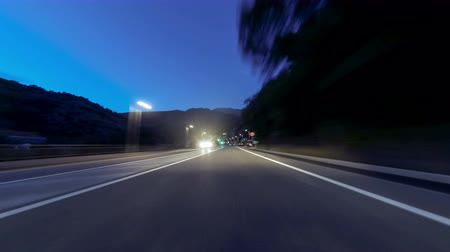 akşam vakti : Fast driving at Vallnord - Ordino (Andorra). Time Lapse. Circulating quickly at evening by road (sequence 2 of 4). Logos, license plates and advertising, have been unfocused manually frame by frame. Time Lapse - Vehicle shot - Point of view - Long exp Stok Video