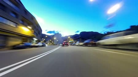 obíhat : Fast driving at Vallnord - La Massana (Andorra). Time Lapse. Circulating quickly at evening by road (sequence 1 of 4). Logos, license plates and advertising, have been unfocused manually frame by frame. Time Lapse - Vehicle shot - Point of view - Long