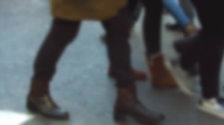 desfocado : Detail of feet passing through a pedestrian crossing. Slow motion Side view feet crossing to street of Barcelona, ??with smooth camera movement: Tracking Shot left.