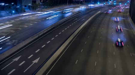 two rows : Scene of traffic at dusk in a main street of entry and exit of Barcelona. Top view.Long exposure. Time Lapse.Trail effect.Logos, car registrations, etc. are blurred blurred frame by frame. Stock Footage
