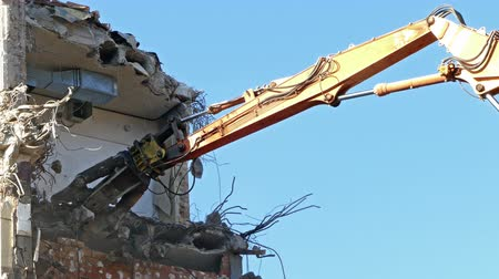 deconstruction : Close-up of heavy demolition machinery at work, cutting of reinforced concrete. Time Lapse