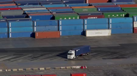 truck crane : Activity in the container terminal.Time Lapse. Maneuvers loading and unloading of a container truck terminal in the port of Barcelona. Stock Footage