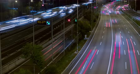 multiple lane : Night scene traffic and roads, top and rear view of entry and exit of Barcelona.Time Lapse - Long exposure - 4K.Smooth motion camera: TILT - PAN - ZOOM and two seconds fixed plane.