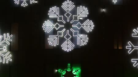 telephoto lens : Christmas symbols LED lights: ice crystal stars and firs.Tilt from bottom to top Stock Footage