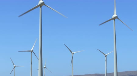 clean electricity production : Many wind-turbines rotating on a sunny day with blue sky. Stock Footage