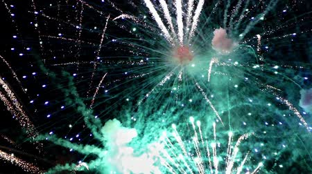 firework display : Detail of fireworks, Large explosions in green and blue colors.slow motion