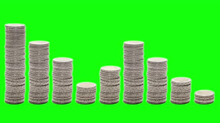 yine : Nine stacks of coins that go down, rise and down again - Stop Motion - Chroma Key. Concept of poverty, ruin, failure.