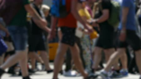 desfocado : Side view blurry pedestrians walking.Time Lapse. People crossing the street in the city of Barcelona. Stock Footage