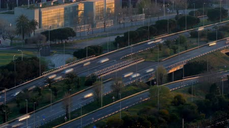 kijárat : Traffic scene and road at sunset. Long Exposure.Time Lapse Road traffic of entry and exit of Barcelona traversing the frame diagonally. Aerial view.