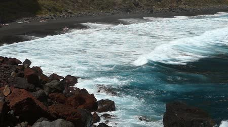 sheen : Panoramic view of the shore of Nogales beach, with many waves and strong wind, on the island of La Palma, Canary Islands, Spain.Slow Motion.