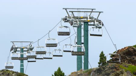 chairlift : Empty chairlift. Moving slowly on the mountain peak.