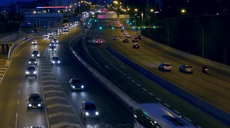 two rows : Night urban traffic scene with the top and rear view roads to Barcelona.With the cars in motion and then they stop.Time Lapse.
