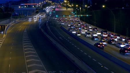 two rows : Night urban traffic scene with the top and rear view access roads to Barcelona. Stock Footage