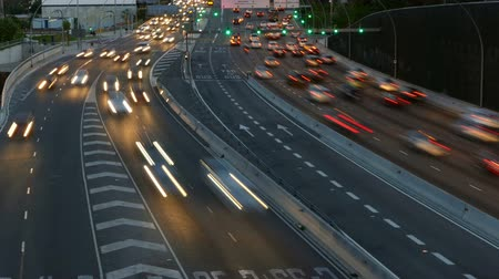 two rows : Traffic at dusk in the main street of entry and exit of Barcelona, ??As it gets dark. Top view. Long Exposure. Time Lapse Stock Footage