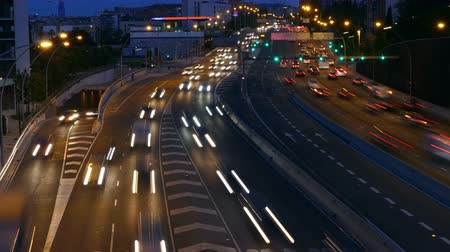 two rows : Traffic at dusk in the main street of entry and exit of Barcelona. Top view. Long Exposure. Time Lapse