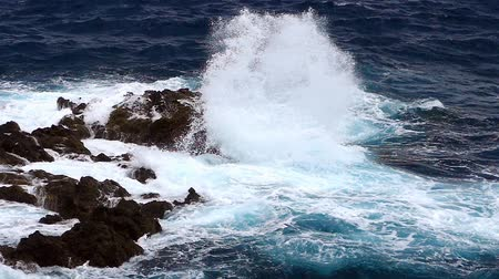 comes : Detail of rocks and waves.Two play speeds. Dangerous rocks and waves in the coastline with strong wind.Two play speeds: real time and the big wave in slow motion.