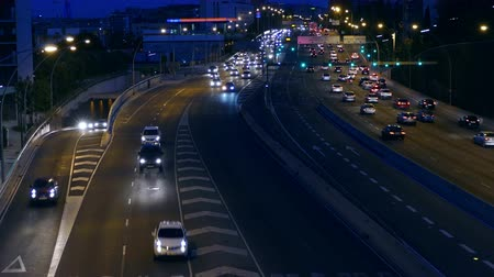 two rows : Night Traffic in Barcelona. Traffic at dusk in the main street of entry and exit of Barcelona. Top view. Stock Footage