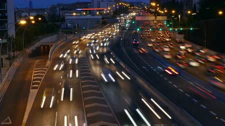 two rows : Cinemagraph of traffic at night in a main street of entry and exit of Barcelona. Top view. Long Exposure. Time Lapse Stock Footage