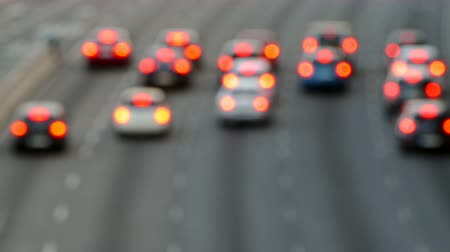many lights : Very blurred evening urban traffic scene with a top and rear view access roads to Barcelona. With the cars in motion and then they stop. Stock Footage