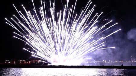 pirotecnia : Green, red and white fireworks over the sea at night in Barcelona.Slow motion