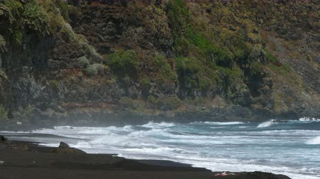 taş duvar : Scenic view of the shore of the beach, with waves and strong wind, in Island of La Palma, Canary Islands, Spain. Stok Video