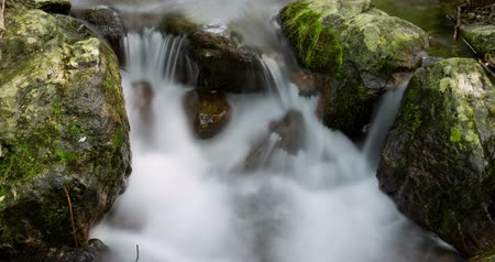 purê : Mountain river with silk effect 12, in which the movement of the sun through the vegetation looks, conveying a feeling of harmony, purity ... Time Lapse - long exposure 4K.Smooth motion camera: PAN