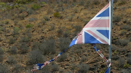 great britain : Old, broken and discolored flag of the United Kingdom moved by the wind