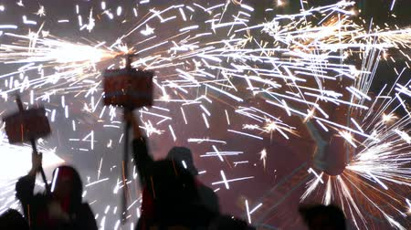Fire Run (Correfoc) traditional celebration of Catalonia, devils dancing among people with fireworks in the hands to the beat of drums.