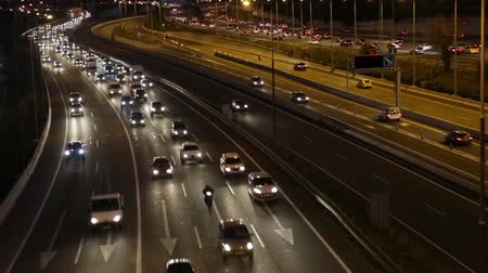 Night scene time lapse traffic and roads top view of entry and exit of Barcelona