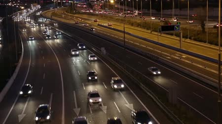 Night scene real time traffic and roads top view of entry and exit of Barcelona