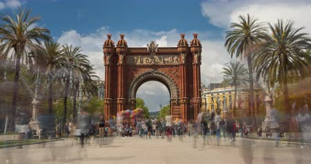 Touristic Barcelona, Arc de Triumph. Time Lapse. Long exposure.Silk effect. Panoramic view of Arch of Triumph with crowd of unrecognizable people (semitransparent) walking.Smooth camera movement: Zoom in