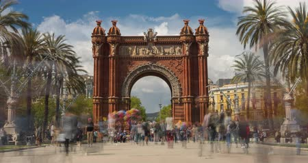 Touristic Barcelona, Arc de Triumph. Time Lapse.Long exposure.Silk effect. Panoramic view of Arch of Triumph with crowd of unrecognizable people (semitransparent) walking.Smooth camera movement: Zoom out Стоковые видеозаписи