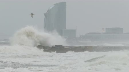 Surge with big waves, strong wind and poor visibility. Groundswell in the Mediterranean sea in Barcelona city beaches.