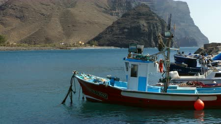 Ancient and small fishing boats. Seascape in the small port of The Village of San Nicolas, island of Gran Canaria, Canary Islands, Spain.