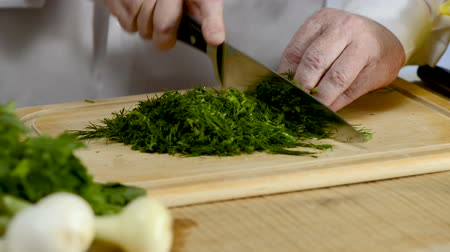 fennel : Hands of the cook knife big kitchen a fresh green fennel on a chopping board from a tree