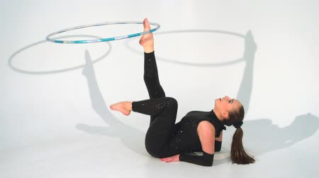 acrobata : Spinning acrobat beautiful toy hoop in slow motion