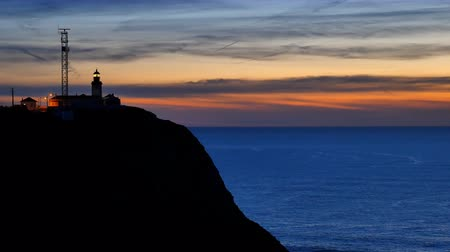 batı : Lighthouse at Cabo da Roca in Portugal at sunset.
