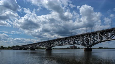 wisla : Clouds in the blue sky over a steel bridge - timelapse Stock Footage