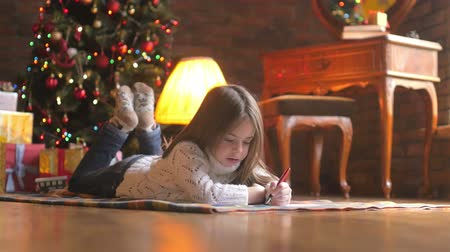 small pen : little girl lying on the floor Stock Footage
