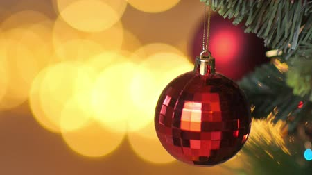 ornamento : childrens hands decorate the holiday tree, bright festive background Stock Footage