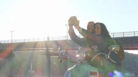 instante : Couple on a scooter make instant selfie photos. Stock Footage