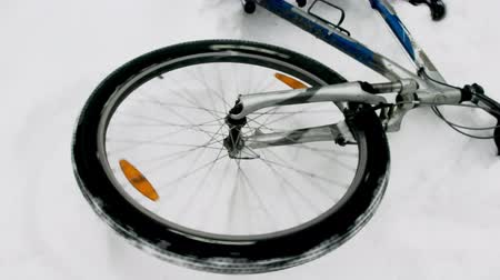 Close up of a wheel of the bicycle. The bicycle in the winter wood lies on one side. Dostupné videozáznamy