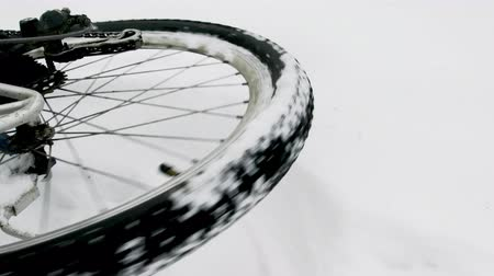 tread : On this video you can see a bicycle wheel. Close up of a wheel of the bicycle. The bicycle in the winter wood lies on one side. Stock Footage