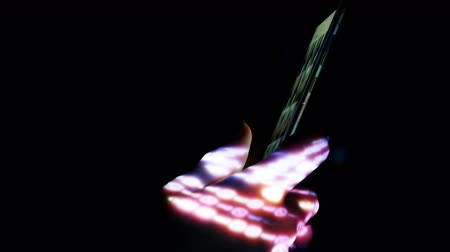 Creative abstract digital visualization projecting on human hand during using smartphone.