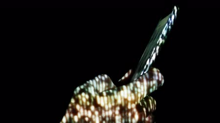 értelem : Creative abstract digital visualization projecting on human hand during using smartphone.