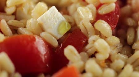 жемчуг : Pearl barley with cherry tomatoes and first salt Стоковые видеозаписи