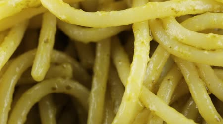 Spaghetti with pesto sauce Stock Footage
