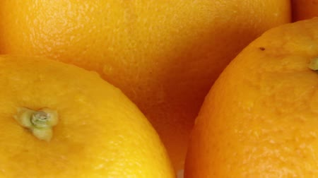 unpeeled oranges Stock Footage